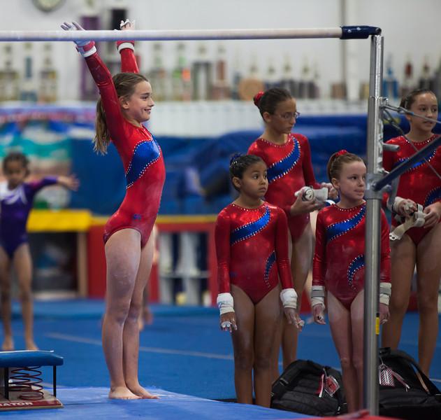 Elizabeth beginning her bar routine, Trevino's Gymnastics District Qualifier (Sep. 2013)