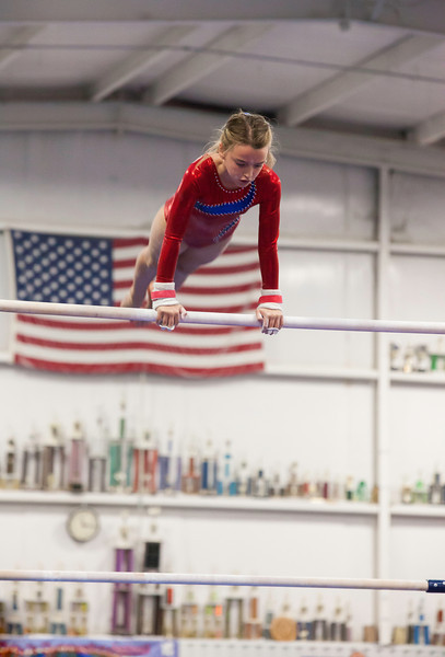 Elizabeth on the high bar, Trevino's Gymnastics District Qualifier (Sep. 2013)