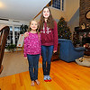 Cassidy Goodall, 7,  (left) stands with her big sister, Emily Goodall, 12, who saved her from choking by using the Heimlich recently, Friday at their Westminster home.<br /> SENTINEL & ENTERPRISE / BRETT CRAWFORD
