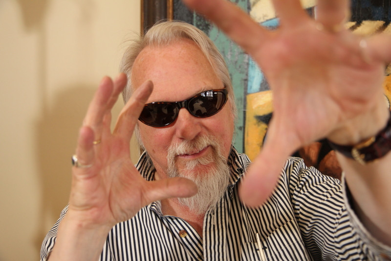 Portrait session of Eric Apoe and a portion of his sun glass collection, by Nick Shiflet, time portal induced by hand gestures.