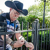 Retired escape artist Roger Lavoie demonstrates his skills in downtown Fitchburg. SENTINEL & ENTERPRISE / Ashley Green