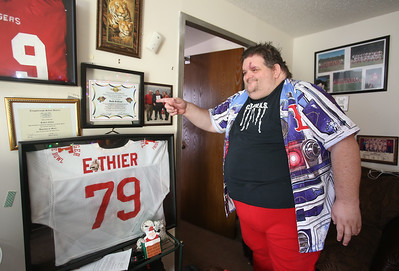 Day in the life of Robert Ethier, 44, of Lowell, who has autism. In his apartment are items from his time on the football and wrestling teams at Tyngsboro High School. (SUN/Julia Malakie)