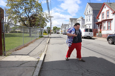Day in the life of Robert Ethier, 44, of Lowell, who has autism, as he takes two buses to get from his home at Jaycee Place Apartments, to the Renaissance Club in Lowell. Ethier listens to music as he walks down Bowers Street on his way to get the bus at University Crossing. (SUN/Julia Malakie)