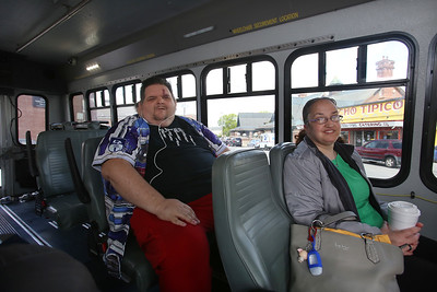 Day in the life of Robert Ethier, 44, of Lowell, who has autism, as he takes two buses to get from his home at Jaycee Place Apartments, to the Renaissance Club in Lowell. Ethier rides the Lowell Circulator bus from near his home, to the Gallagher Terminal, where he changes for another bus. At right is passenger Trina Gardner of Lowell. (SUN/Julia Malakie)