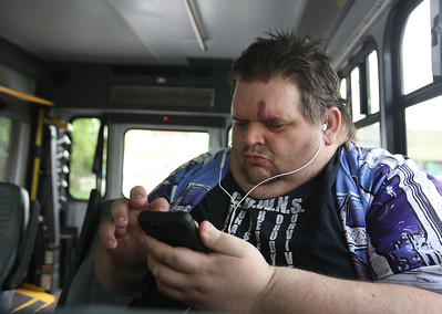 Day in the life of Robert Ethier, 44, of Lowell, who has autism, as he takes two buses to get from his home at Jaycee Place Apartments, to the Renaissance Club in Lowell. He likes to listen to music on his way. (SUN/Julia Malakie)