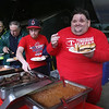 Bob Ethier of Lowell goes through the food line at the Spinners' annual Season Ticket Holder BBQ at LeLacheur Park.  (SUN/Julia Malakie)