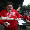 Bob Ethier of Lowell goes to the Spinners' annual Season Ticket Holder BBQ at LeLacheur Park.  Ethier <br /> holds his bat and two balls that were autographed by all the players. At right is new manager Luke Montz.(SUN/Julia Malakie)