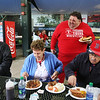 Bob Ethier of Lowell goes to the Spinners' annual Season Ticket Holder BBQ at LeLacheur Park. Ethier chats with other season ticket holders including, from left, Larry Norman of Billerica and Lorraine and husband Francis Larmand of Lowell. (SUN/Julia Malakie)