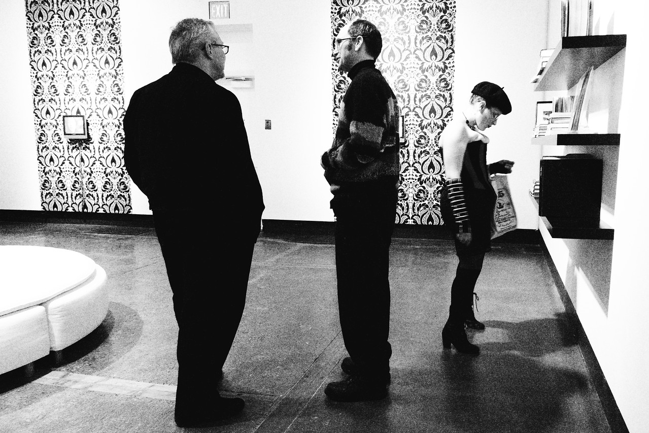 "Patrons converse in the resource room at KW|AG's presentation of ""Pandora's Box."""