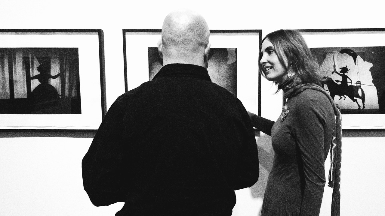 "Patrons discuss artwork on exhibit at KW|AG's presentation of ""Pandora's Box."""