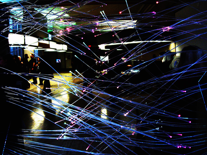 A set of fibre-optic strands, lit by LEDs in two plinths, emit colours dependent on an extraction of the Twitter feed from within a 50km radius of the exhibition.  (The artistic statement on this piece was the worst bit of hyperbolic art-school bullshit I have ever read, and the writer should be ashamed.)