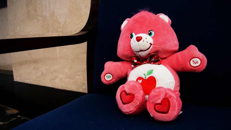 This friendly Care Bear invites you to sit next to him and pick him up.  But when you hold his hands, a security alarm goes off.