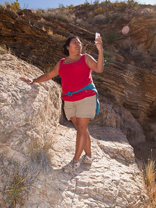 Nope, no phone service at Ernst Tinaja.  Cell service is very spotty all over the Big Bend region.