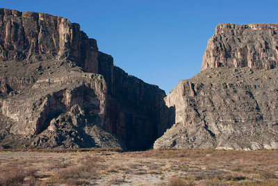 The cliff walls of Santa Elana canyon are about 1500 feet high.  Mexico is on the left, the United States in on the right.