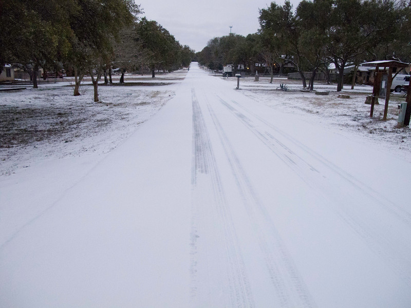 There is a sheet of ice beneath the snow, making driving treacherous.  As can be seen in this picture only a very few people have been driving today.  Austin has seen 100s of wrecks in the past 12 hours.
