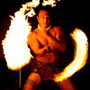 February 10, So tired of cold weather so I dug into the vault and found this warm image from the tropics. This guy was amazing and performed  his fire dance at a Luau on the island of Maui, Hawaii. This was before I had a fast lens so I had to rely on luck for focus on his face while trying to get motion to highlight the action.