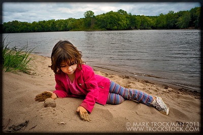 Hayley Trockman, five, makes little beach balls on the shore of the St. Croix River in WIld River State Park, near Center City, Minn., Sunday, Sept. 4, 2011.