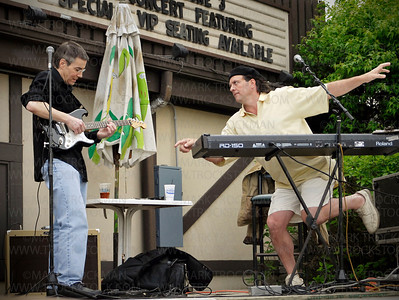 Musician Dave Kieski, right, performs for an early summer audience at Lord Fletcher's Old Lake Lodge on Lake Minnetonka in Spring Park, Minn.