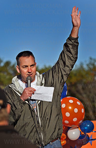 Deephaven Elementary School principal Bryan McGinley tells the crowd of parents and students gathered Saturday morning for the Distance for Deephaven walk that they had already raised nearly $20,000 for the school.  The school abandoned the long established fundraiser of selling candy and gift wrapping and the Deephaven Elementary's PTA created a fitness fundraiser that also builds community spirit.  Deephaven Elementary School physical education teacher Carrie Senske, right, leads Distance for Deephaven participants in warm-ups before the start of the fundraiser walk Saturday, Oct 2, 2010.
