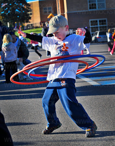 Deephaven Elementary School student Dalton Ward, 6, controls three hula hoops as participants in Saturday's Distance for Deephaven fundraiser gather for the start of the walk to raise funds for the school.  According to principal Brian McGinley the school had raised almost $20,000, which is $5,000 more than they had expected.