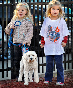 Dog corralling was an integral part of the Distance for Deephaven walk to raise funds for Deephaven Elementary Saturday, Oct. 2