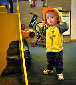 Donning a hardhat,  Zvi Uran Markman, 23 months, Hopkins, plays in the Main Street garden at the Hennepin County Library in Hopkins Thursday, Aug. 26, 2010.