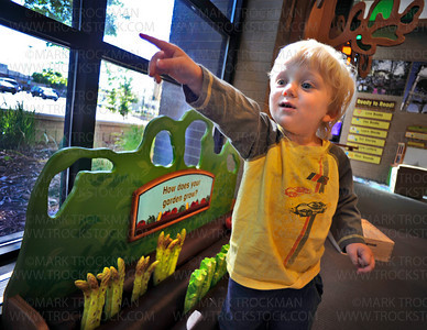 Nearly two years old and he's directing imaginary farmhands.  Zvi Uran Markman, 23 months, Hopkins, plays near the Main Street garden where he 'planted' plastic asparagus at the Hennepin County Library in Hopkins Thursday, Aug. 26, 2010.