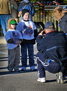 Second grader Jason Davenport, 7, left, and his bother Colton, 4, stand for a photograph by their dad, Jeff, while braving the early morning chill before the start of the Distance for Deephaven walk to raise funds for Deephaven Elementary Saturday, Oct. 2. The school abandoned the long established fundraiser of selling candy and gift wrapping and the Deephaven Elementary's PTA created a fitness fundraiser that also builds community spirit.
