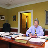 Fitchburg State University President Robert Antonucci sits at his desk in his office after announcing his retirement on Monday. SENTINEL & ENTERPRISE/JOHN LOVE