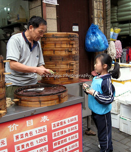 A young girl buying dumplings - Shanghai