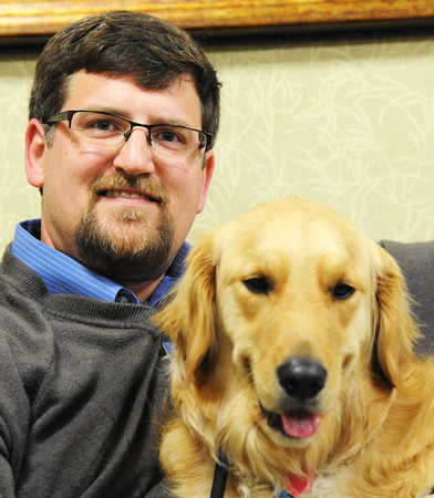 Globe/T. Rob Brown<br /> Faces of Recovery: Jason Glaskey with Louie, a comfort dog, of Immanuel Lutheran Church through Lutheran Church Charities.