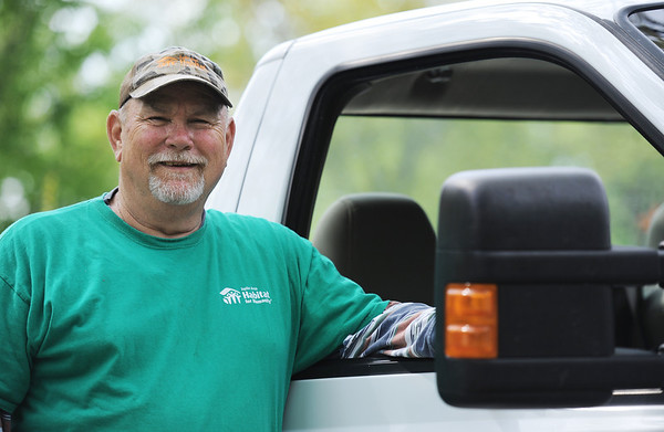 Globe/T. Rob Brown<br /> Faces of Recovery: John Williams with Habitat for Humanity.