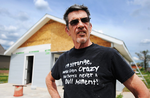 Globe/T. Rob Brown<br /> Faces of Recovery: Mike Hamilton volunteer in front of one of the houses he is helping rebuild in the tornado zone.
