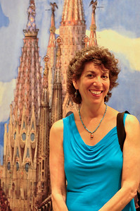 Standing in front of a rendering of the LaSagrada Familia.