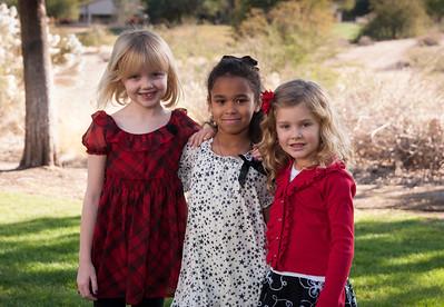 Three kids enjoying the beautiful outdoor weather.