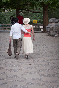 Strolling in the park - So kind of the gentleman to carry the woman's purse in the heat of the day.
