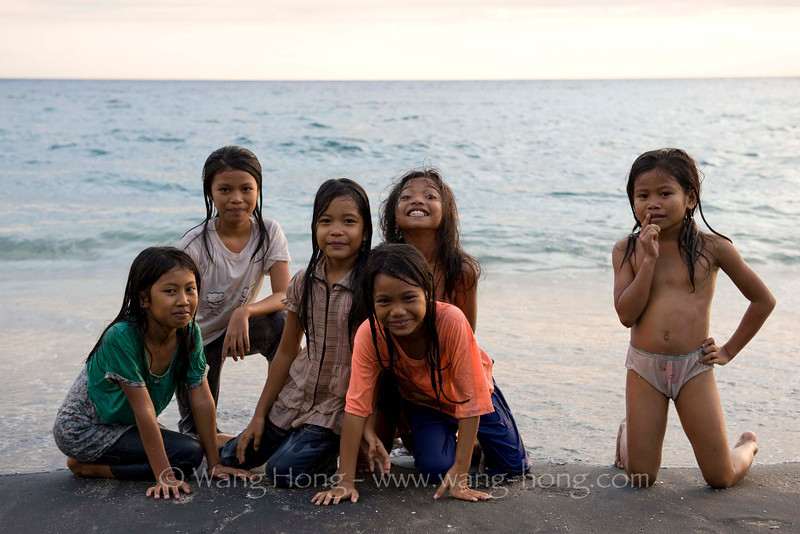 Girls enjoying sunset time on the beach in Mansit Village, Lombok, Indonesia