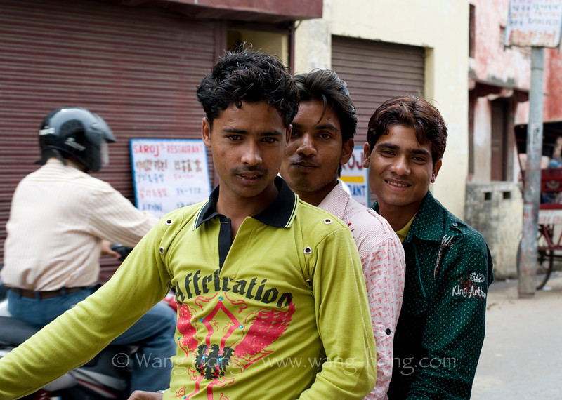 Young Indians on a motor bike in Agra just outside Taj Mahal