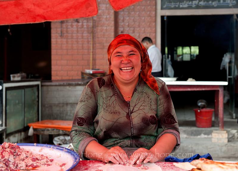 Happy lady selling steamed dumplings at a market in Kashgar, Xinjiang, summer 2012.