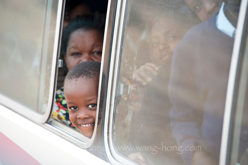 Sweet girl in a school outing bus in the Tarangire National Park, northern Tanzania, December 2010.