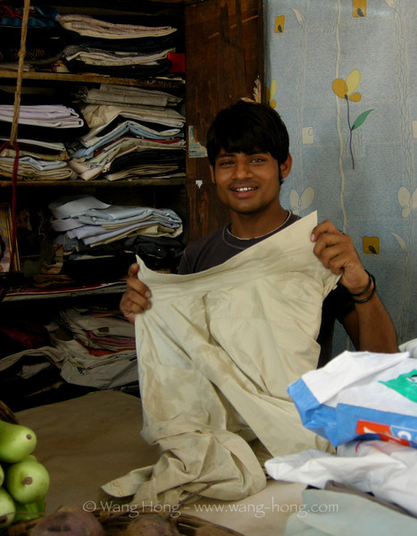 Laundry man near Victoria Station in Mumbai, India