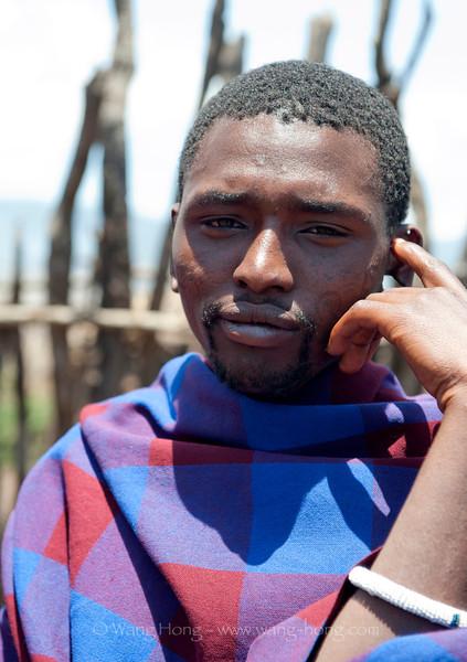 Man in a Maasai village in the Ngorongora Conservation Area, northern Tanzania, December 2010.