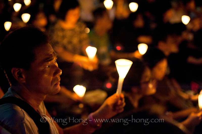 Man at the candle lit vigil in remembrance of Tian'anmen movement in 1989, Victoria Park, Hong Kong on June 4, 2014.