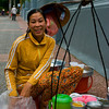 Young lady selling Tofuhua and other snack on the street in Ho Chi Ming City, Vietnam