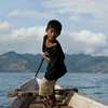 Little captain operating ferry from Lombok to Gili Air Island in Indonesia