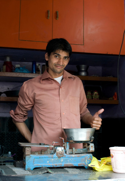 Young Indian running a yogurt shop in Agra, India