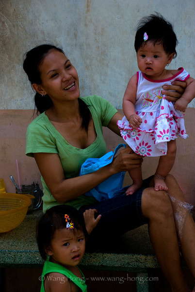 Young mother having fun her kids, Ho Chi Ming City, Vietnam