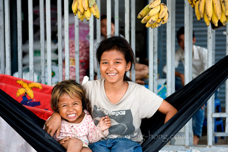 Sisters at the local market, Sihanoukville, south Cambodia, December 2010.