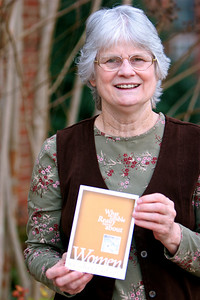 "Sheri Adams with her book; ""What the Bible Really Says About Women."""