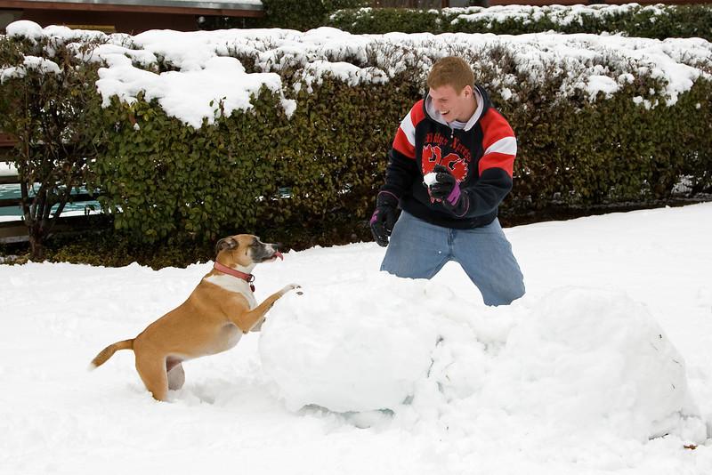Sadie rolls up a snowball